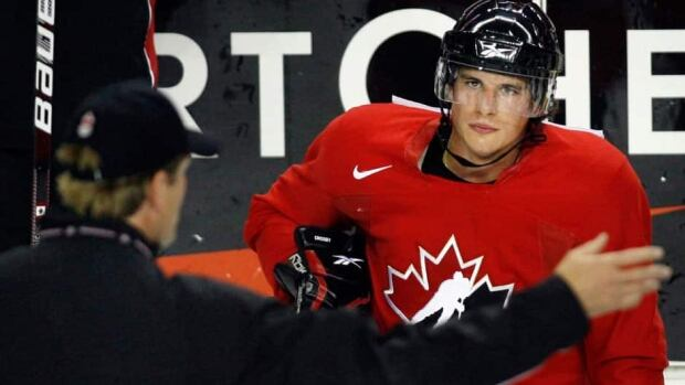 Sidney Crosby listens to instructions from head coach Mike Babcock at Canada's Olympic orientation camp four years ago in Calgary. Babcock is back to guide the latest squad, and Crosby again figures to be a key player.