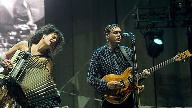 Win Butler, right, and Regine Chassagne of Arcade Fire perform in Montreal last September. Groups representing Canadian performers and music labels want the federal government to amend its copyright act to end a break on royalties paid by commercial radio stations.