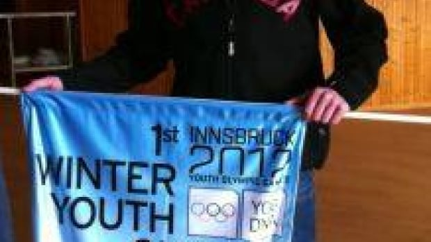 Thomas Scoffin has donated the banner from his medal-winning performance at the Youth Olympics to the Whitehorse Curling Club.