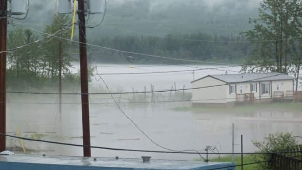 Flooding in Nahanni Butte, N.W.T., in 2012 forced residents to evacuate to Fort Simpson. A report by the Monk-Gordon Arctic Security Program this spring is expected to provide recommendations to help Northern communities better prepare for natural disasters.