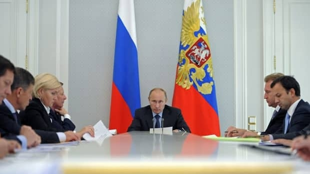 Russian President Vladimir Putin chairs a government meeting in the Black Sea resort of Sochi, southern Russia, on Tuesday.