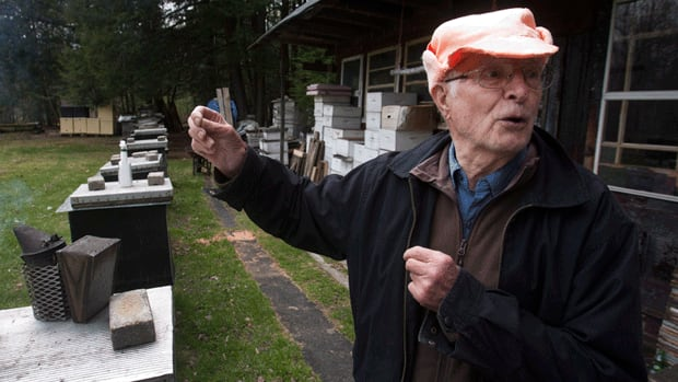 Vladimir Katriuk gestures at his honeybee farm in Ormstown, Que. Katriuk, alleged to be one of the world's most-wanted Nazi war criminals, is living a quiet life keeping bees and selling honey in rural Quebec.
