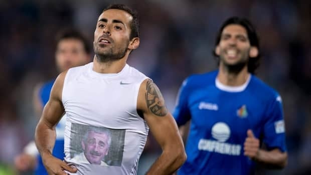 Getafe's Diego Castro celebrated his goal on Monday by lifting his shirt to reveal a T-shirt with the photo of Manuel Preciado, who died of a heart attack in July. Preciado had coached Castro at Sporting Gijon.