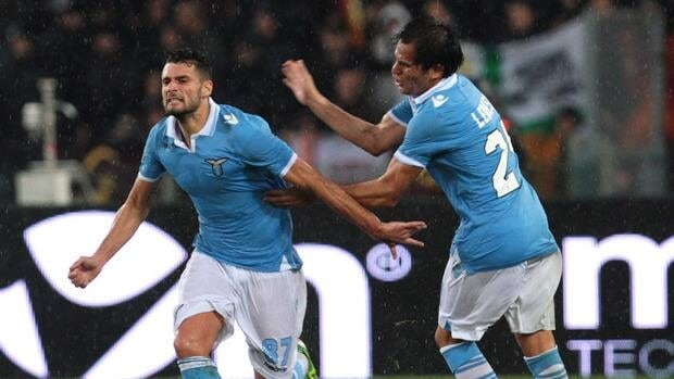 Lazio's Antonio Candreva, left, and Cristian Ledesma celebrate a goal against Roma at Stadio Olimpico on November 11, 2012 in Rome, Italy.