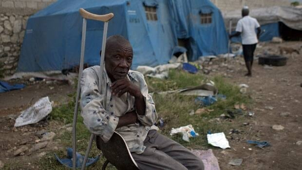 Rezilhome Diverne 68, a victim of the 2010 earthquake, sits outside his tent at a camp for people displaced by the 2010 earthquake in Port-au-Prince, Haiti.