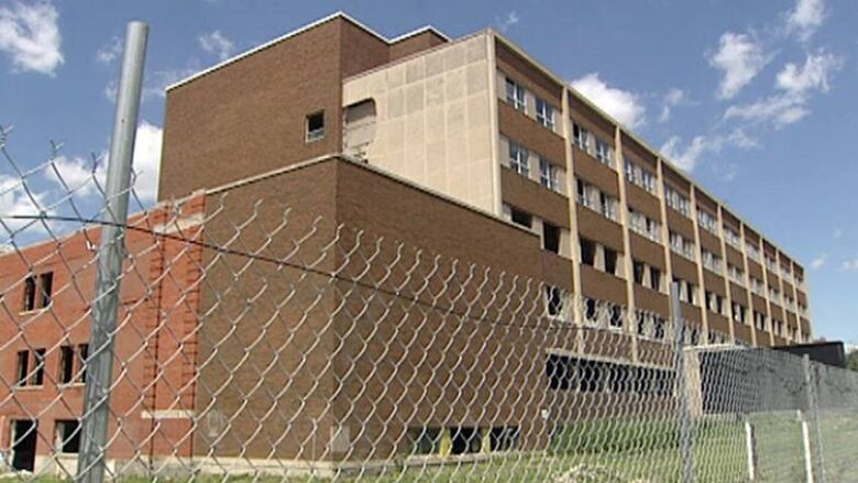 Asbestos charges laid against former owner of Grace Hospital