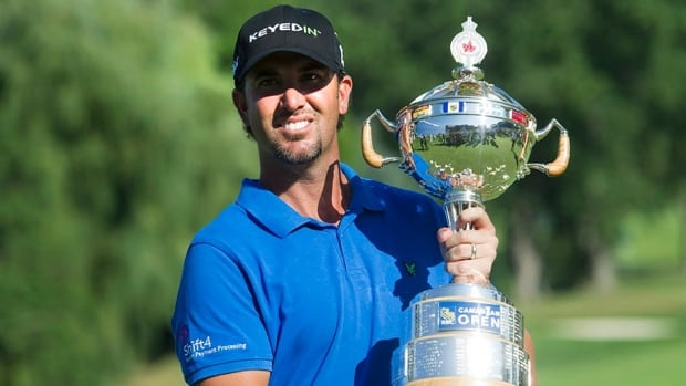 Scott Piercy holds the championship trophy after winning last year's Canadian Open at the Hamilton Golf and County Club in Hamilton, Ont., on Sunday, July 29, 2012. The field will be stacked this year as Piercy looks to defend his title.