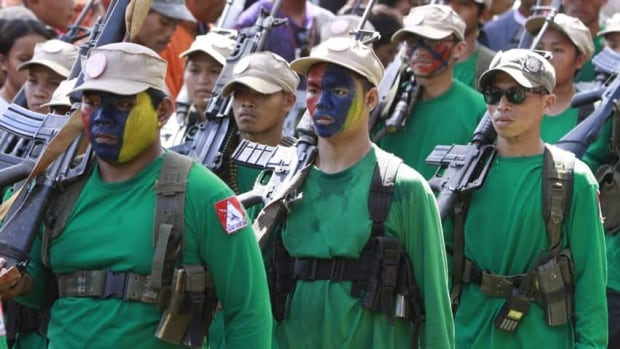 Members of the New People's Army, seen here at the celebration of the 42nd anniversary of the Communist Party of the Philippines in Dec. 2010, have agreed to a truce.