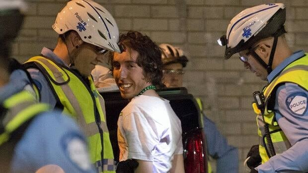 A protester is arrested after a clash with police at the corner of Crescent and St. Catherine streets in Montreal near the Grand Prix festival site on Saturday.