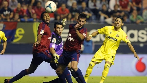 Midfielder Javier Aquino, right, and Villarreal have returend to top flight and sat as overnight leader before Sunday's matches.
