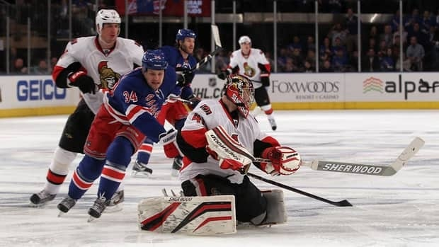 Senators Goalie Craig Anderson (41) skates far out from the net to clear the puck against New York Rangers centre John Mitchell (34) during Game 1 on Thursday.
