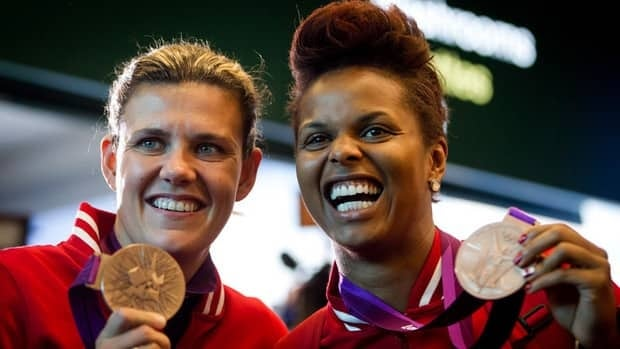 Canadian women's soccer team captain Christine Sinclair, left, and goalkeeper Karina LeBlanc show off their bronze medals from the London Olympics last month.