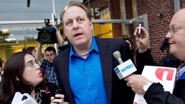 Former MLB pitcher Curt Schilling, centre, and his company filed for bankruptcy last year.
