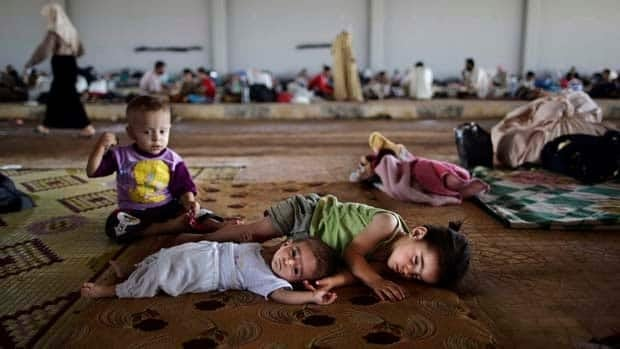 Syrian children who fled their home take refuge at the Bab Al-Salameh border crossing last month in hopes of entering one of the refugee camps in Turkey, near the Syrian town of Azaz.