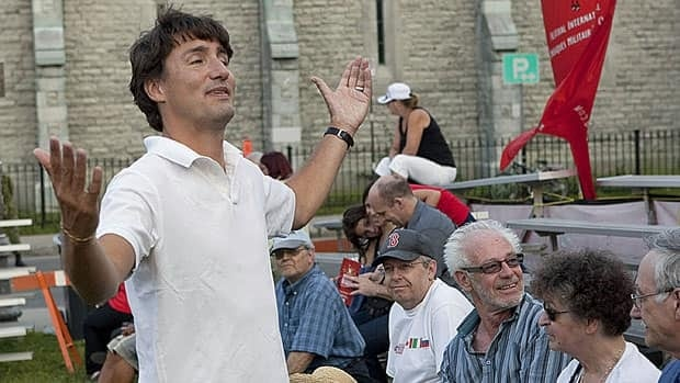 Liberal Leader Justin Trudeau, who joined concertgoers at the Festival de Musique Militaire in Quebec City Wednesday, says a proposed ban on religious symbols and the wearing of religious garb by public sector workers in Quebec would damage the province's reputation.