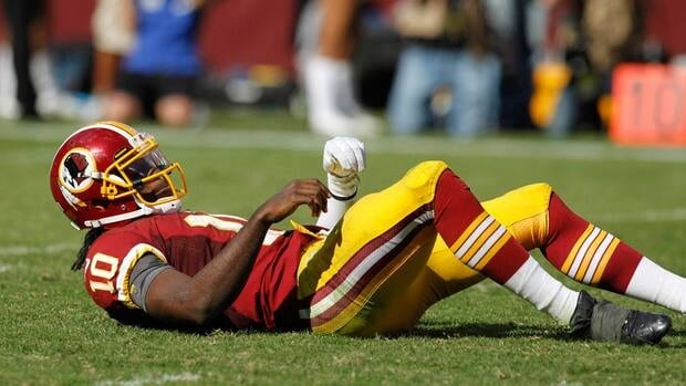 Washington Redskins Robert Griffin III, shown here during a Sept. 23 game, suffered a concussion on Sunday.