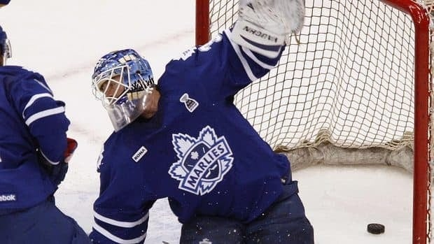 A shot by Norfolk Admirals' Richard Panik gets under Marlies goalie Ben Scrivens for a first-period goal in Game 2 of the AHL Calder Cup final on Saturday night in Virginia.