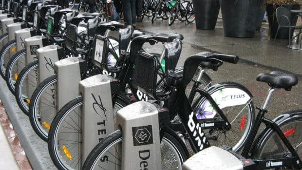 Bicycles are lined up as the public bike-sharing system launched in Toronto last May 3. Pat Hewitt/CP