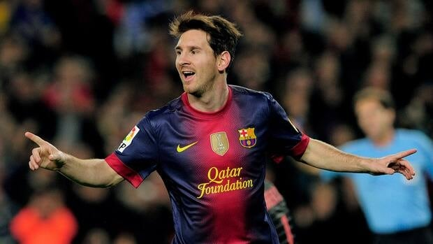 Barcelona's Lionel Messi celebrates after scoring against Real Zaragoza at Camp Nou stadium in Barcelona on November 17, 2012.