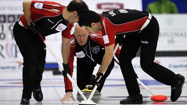 Ontario skip Glenn Howard, centre, watches his shot as second Brent Laing, left, and lead Craig Savill sweep during a morning draw against British Columbia at the Brier on Wednesday.