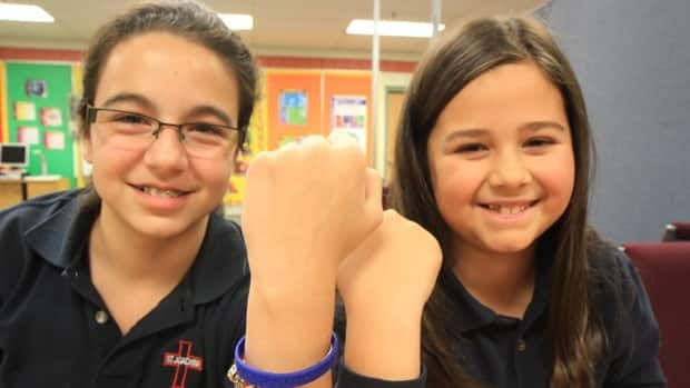 Ariana Figueiredo and Sofia Grimaldi show off thier 'You Can Stop Bullying' bracelets. The Grade 6 students will donate the proceeds from bracelent sales to Anti-Bullying Canada.