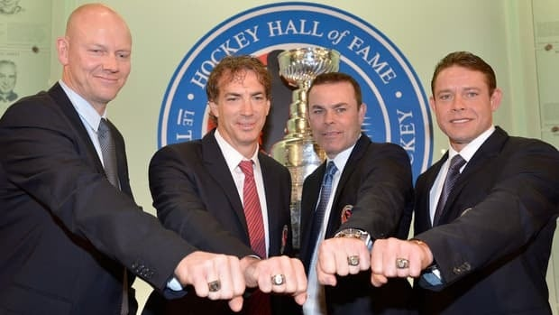 Hockey Hall of Fame inductees, from left, Mats Sundin, Joe Sakic, Adam Oates and Pavel Bure, pose for a photograph with their rings at the Hockey Hall of Fame in Toronto on Monday.