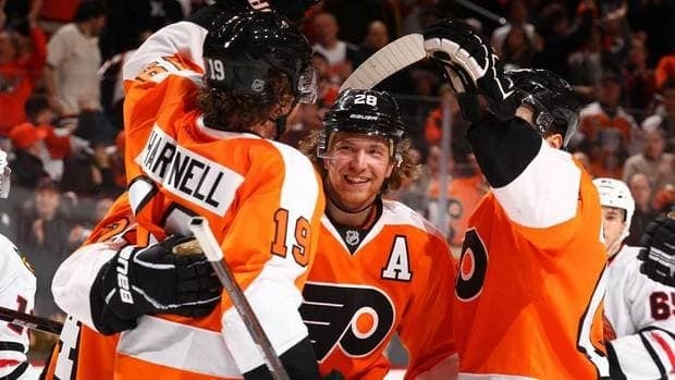 Scott Hartnell, left, of the Philadelphia Flyers celebrates his goal with Claude Giroux, centre, during their game against the Chicago Blackhawks on Thursday.