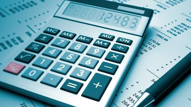 Penticton taxpayer Judie Shinz used a calculator to uncover an error on every property owner's tax bill in the city.