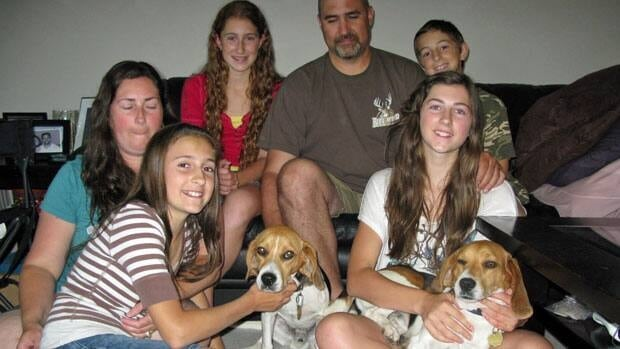 The Pachnosky family has been reunited with their beloved beagles, Bandit and Shooter, after the canines took off into the bush to chase a bear.