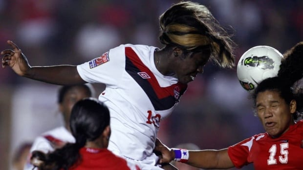 Christabel Oduro, top, and Team Canada lost 2-1 to Norway in Kobe, Japan, on Thursday.