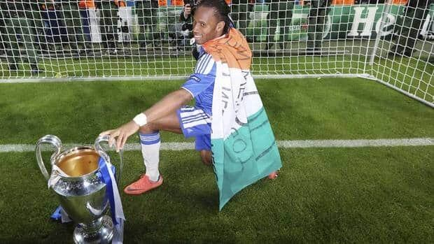 Chelsea's Didier Drogba poses with the trophy after the Champions League final on Saturday. The club announced Sunday it will try to re-sign the man who won the game for the Blues.