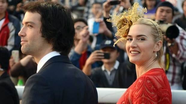 British actress Kate Winslet, right, has married boyfriend Ned RocknRoll. They are shown Dec. 9 in Hong Kong.
