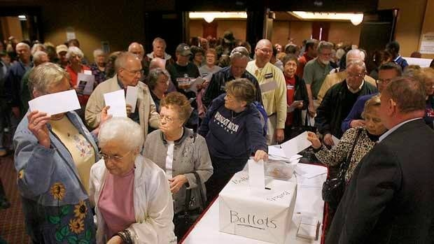 Votes are cast following Republican candidate speeches in Topeka, Kan., on Saturday.