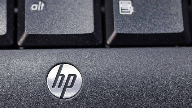 This Nov. 14, 2011 photo, shows the company logo on a Hewlett-Packard keyboard at the Micro Center computer store in Santa Clara, California. HP's stock plunged 13 per cent after CEO Meg Whitman's presentation Wednesday, shoving the company's shares to their lowest level in nearly a decade.