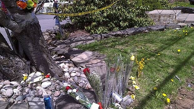 Flowers mark the site of Saturday's fatal crash in Sydney, N.S.