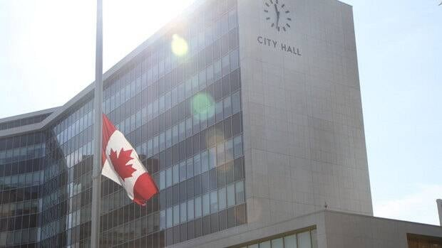 The Canadian flag outside Hamilton's city hall flies at half staff Friday for Lincoln Alexander.