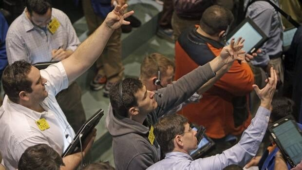 Traders work in the oil options pit at the New York Mercantile Exchange on March 14, 2012. A U.S. government agency is projecting prices for Brent crude to remain under $100 a barrel until the end of 2013.