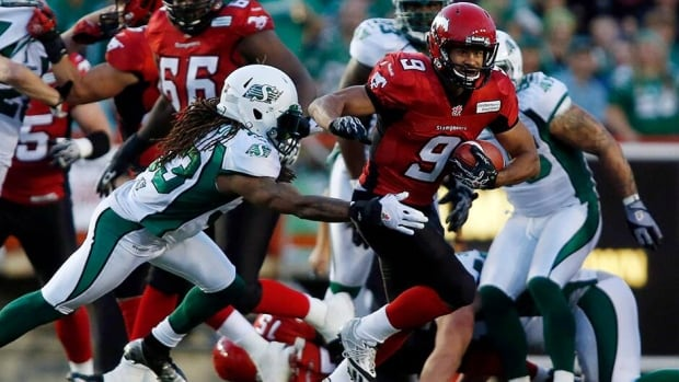 Saskatchewan Roughriders' Dwight Anderson, left, tries to stop Calgary Stampeders' Jon Cornish during second half CFL football action in Calgary last week. The B.C. Lions' self-imposed top task this week is to stop Cornish and the Stampeders running game.