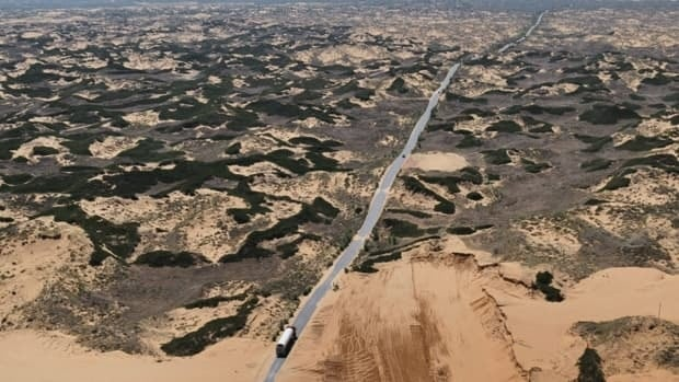 An oil tanker drives through desertified land in northwest China's Shaanxi province. Nations signed a convention to combat desertification in 1994 but have made little progress in halting the destructive process.