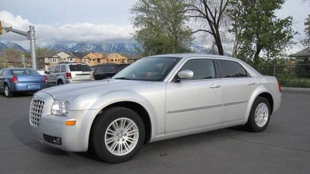 Police are looking for three suspects who left the scene of a robbery in a 2010 grey Dodge Chrysler 300.