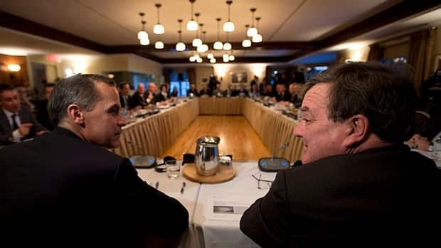 Bank of Canada Governor Mark Carney (left) speaks to Finance Minister Jim Flaherty prior to the start of a meeting with provincial finance ministers on Monday.