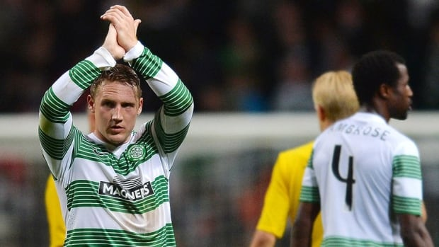 Kris Commons of Celtic acknowledges the applause from the crowd at the end of the UEFA Champions League Third Qualifying Round First Leg match between Celtic and Elfsborg at Celtic Park Stadium on Wednesday in Glasgow, Scotland.