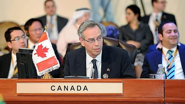 Minister of Natural Resources Joe Oliver delivers remarks to the assembly at the International Energy Forum in Kuwait City, Kuwait on March 13. Oliver told delegates that oilsands oil contributes to the world's energy security.