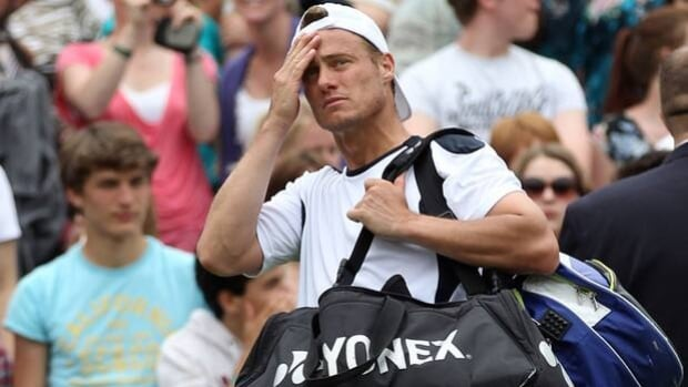 Lleyton Hewitt reacts to a 6-3, 6-4, 6-4 loss to Jo-Wilfried Tsonga at Wimbledon on Tuesday.