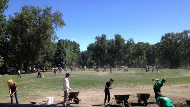 Volunteers at Prince's Island Park work to get it ready for the Calgary Folk Music Festival.