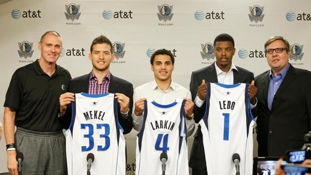 Dallas Mavericks head coach Rick Carlisle, left, Gal Mekel, Shane Larkin, Ricky Ledo pose with President of Basketball Operations and informal general manager Donnie Nelson, right, earlier this month. A formal replacement for Nelson was named on Monday.