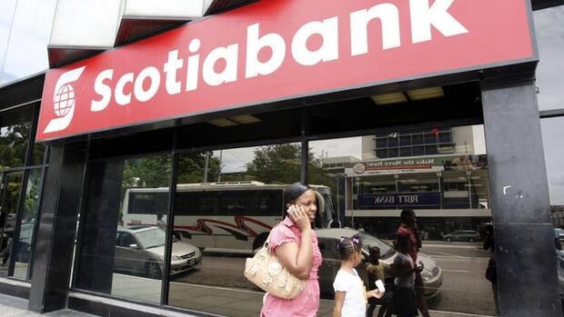 Scotiabank is Canada's most international bank, with branches around the world, including in Port of Spain, Trinidad and Tobago, above. The bank reported a slight rise in revenue in the third quarter and hiked its dividend by two cents.