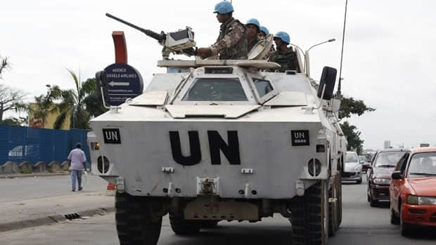 Jordanian United Nations soldiers drive in a UN armoured personnel carrier, in Abidjan, Ivory Coast, in 2011. The UN spent $76 million US on private security contracts in 2010, with $18.5 million of that for UN peacekeeping operations.