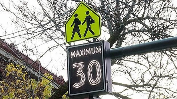 The speed limit in school zones is 30 km/h between 8 a.m. and 5 p.m. on any school day.