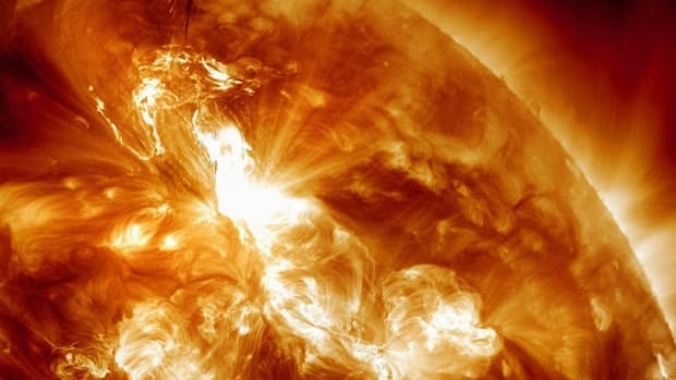 A solar flare is seen erupting on the Sun's northeastern hemisphere on Sunday night. Physicist Doug Biesecker said the biggest concern from the speedy eruption is the radiation, which arrived on Earth an hour later. It will likely continue through Wednesday.